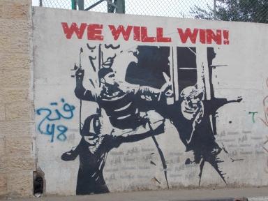 """Venceremos!"" (graffiti en Aida)"