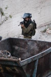 photo-by-palestinian-photographer-mohammad-al-azza-of-the-israeli-soldier-who-seconds-later-shot-him-in-the-face-with-a-rubber-coated-steel-bullet