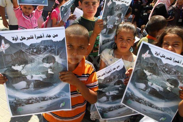 Niños y niñas conmemoran el aniversario de al Nakba en Gaza, en 2011 (Ashraf Amra)
