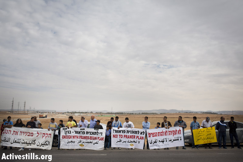 Activists and Bedouin residents protest against the Israeli Knesset Internal Affairs Committee tour in the Negev, regarding the Prawer plan, in the Bedouin village of Al Sayyed, Novmber 24, 2013