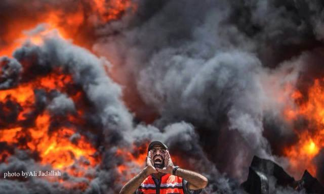 A Palestinian firefighter reacts as he tries to put out a fire at Gaza's main power plant, which was hit in Israeli shelling, in the central Gaza Strip July 29, 2014.