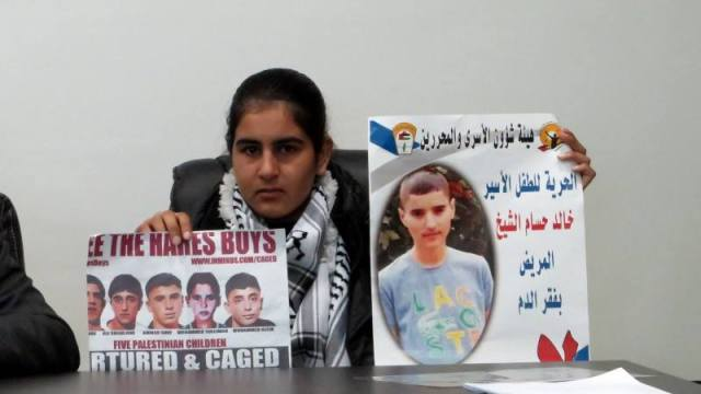 Malak al-Khatib, 14-year-old Palestinian from a village in Ramallah who was kidnapped in December by the Israeli occupation army and sentenced to 2 months in prison for alleged stone-throwing and possessing a knife. The army kidnapped her on her way home from school. Malak is holding a poster of the Hares Boys and of Khaled, another 14-year-old sentenced to 4 months in prison for alleged stone-throwing. Khaled has anemia and his health in the prison is deteriorating.