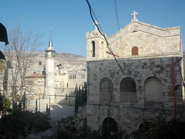 Antiguas iglesia anglicana y mezquita a la entrada de la Ciudad Vieja de Nablus.