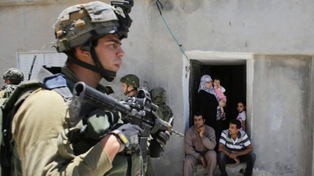 Israeli soldiers patrolling near the West Bank city of Hebron, June 15, 2014.Reuters