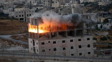 Israeli forces placed explosives in a multi-story building in the neighborhood of Wadi Hummus on the outskirts of occupied East Jerusalem on 22 July.