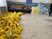 Acopio de alimentos y otros artículos donados a la población de Aida.