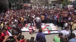 Funeral de los 8 niños/as y 2 mujeres de la familia Abu-Hatab asesinados mientras dormían.